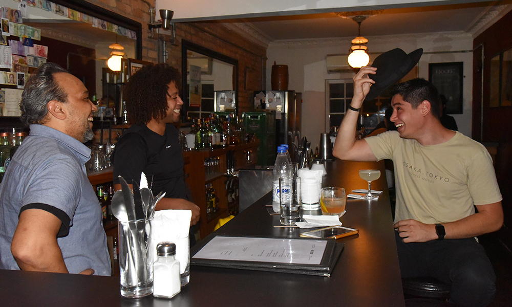 The Brazilian bartender, Kennedy Nascimento, along with the owners of Boca de Ouro Bar