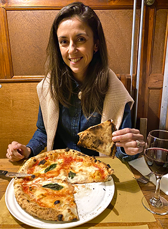 Malu Neves eating pizza napoletana at the Bella Storia restaurant in Amsterdam