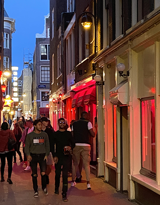 Tourists strolling around the Red Light District in Amsterdam