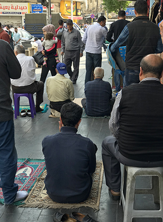 Muslim on the streets of Amman preparing for call to prayer Adhan