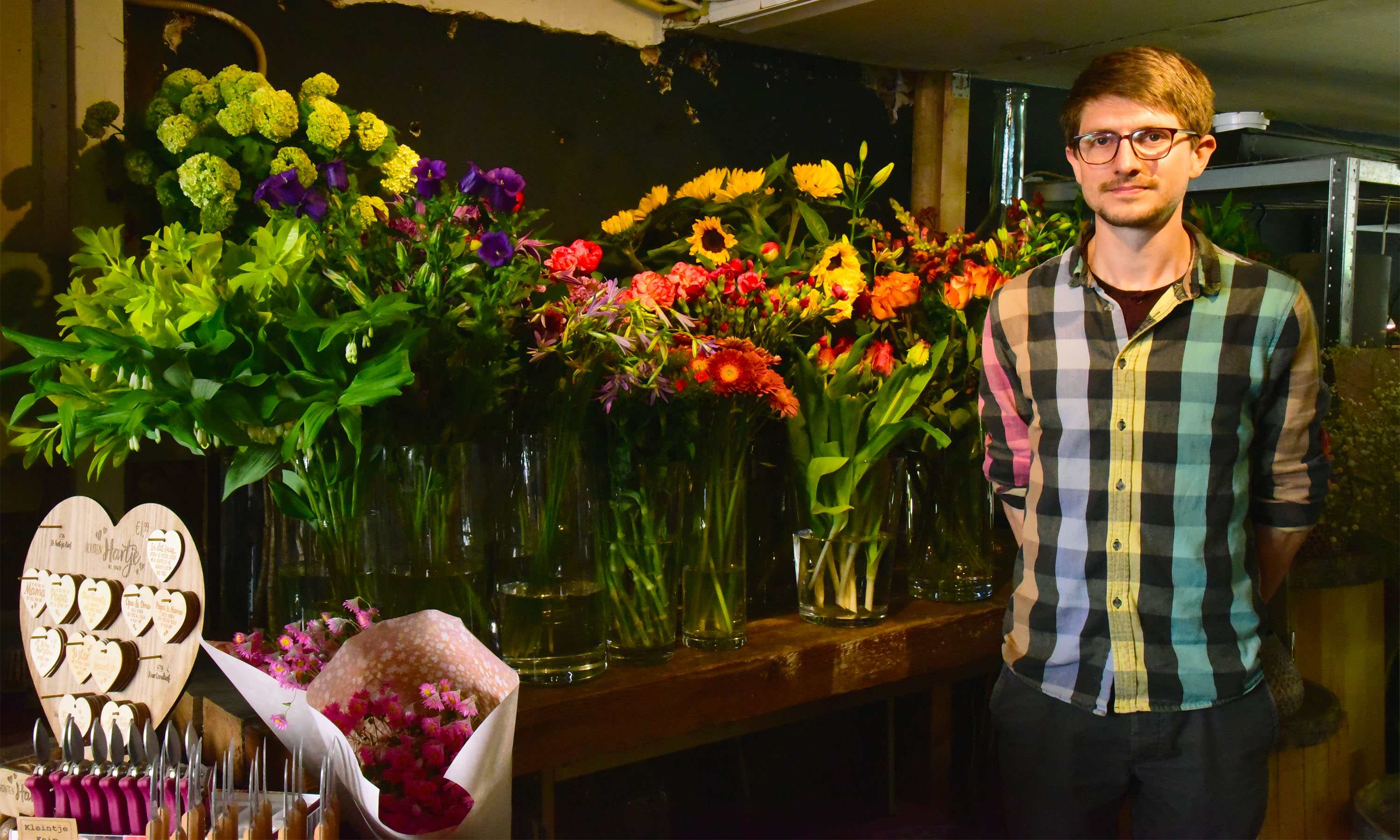 The Dutch florist Dennis Lanzaat poses for a photo shooting at his flower shop in Amsterdam