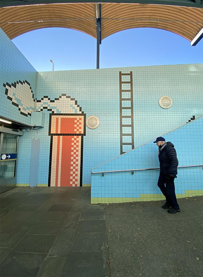 A man walks by the Thorildsplan subway station in Stockholm