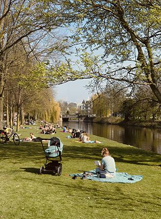People sunbathe at Westerpark in Amsterdam